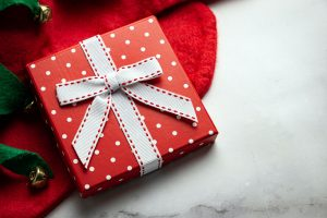 Chrismas Gift on a Red Cloth