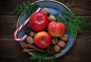 Christmas composition with apples, nuts and cinnamon