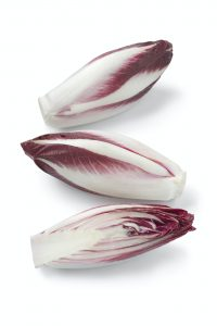 Whole and half raw Italian Radicchio rosso