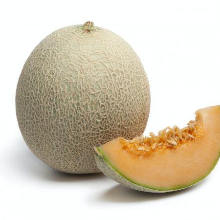 Whole Cantaloupe melon with a slice